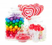 picture of gumballs  - A display of various candies in glass containers - JPG