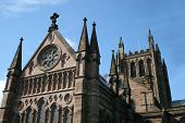 stock photo of hereford  - West end of Hereford cathedral against blue sky - JPG