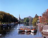 stock photo of avon  - River Avon with pleasure boats moored and Church to rear Stratford - JPG