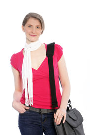 picture of sling bag  - Stylish casual woman with sling bag wearing jeans a red summer top and a decorative neck scarf standing in a relaxed pose with her hand in her pocket on white - JPG