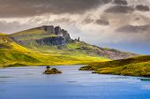 stock photo of cloud formation  - Landscape view of Old Man of Storr rock formation and lake Scotland United Kingdom - JPG