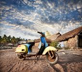 picture of beach hut  - Old retro scooter on the sandy beach near fishermen huts in the tropical village in India - JPG