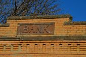 Copper bank sign on an old historic brick  building