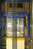 foto of elevator  - Modern elevator shaft interior with cables and tracks - JPG