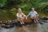 brother and sister in the creek