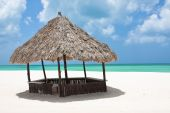stock photo of beach hut  - A Hut sits on the sandy white beach of a Mexican island - JPG
