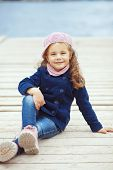 picture of little girls photo-models  - Portrait of 4 years old girl walking on berth near sea in the city - JPG