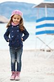 stock photo of little girls photo-models  - Portrait of 4 years old girl walking near sea in the city - JPG