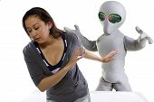 stock photo of x-files  - young woman is the victim of an alien abduction - JPG