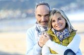 image of couple sitting beach  - Senior couple sitting by the beach - JPG