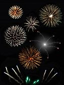 stock photo of firework display  - Colorful night time display of many lit fireworks - JPG