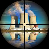 Nuclear power plant in a terrorist's weapon gunsight. Nuclear safety concept.