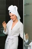 foto of shower-cubicle  - Young woman in the hotel bathroom - JPG