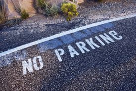 picture of g-spot  - No Parking Sign on Pavement with Inverted G Letter by Mistake - JPG