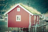 foto of reining  - Typical Norwegian fishing village with traditional red rorbu huts Reine Lofoten Islands Norway - JPG