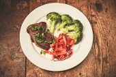 image of red meat  - Meat and vegetables including broccoli and red peppers on a plate - JPG