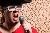 picture of crazy hat  - Crazy rock and roller singer with a big black hat - JPG
