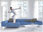 picture of freaky  - Picture of freaky man dancing on a blue couch - JPG