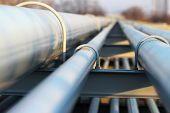stock photo of gas-pipes  - detail of steel light pipeline in oil refinery - JPG