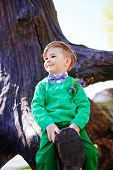 stock photo of baby cowboy  - Cute little boy playing on the playground outdoor - JPG