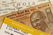 picture of mahatma gandhi  - Trip to India concept with Indian rupee and baording pass - JPG