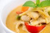 foto of curry chicken  - Macro of garnished chicken red curry from Thailand with seasonal vegetables - JPG