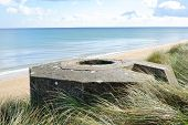 stock photo of ww2  - Tobruk bunker WW2 Utah Beach is one of the five Landing beaches in the Normandy landings on 6 June 1944 during World War II - JPG