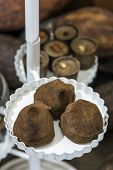 picture of bonbon  - Chocolate bonbons in dish and cocoa on background - JPG
