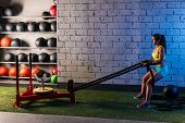 picture of sled  - sled rope pull woman pulling weights workout exercise - JPG