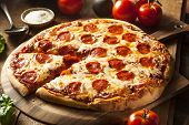stock photo of hot fresh pizza  - Hot Homemade Pepperoni Pizza Ready to Eat - JPG