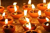 pic of diwali  - oil lamps lit on diwali festival in rows - JPG