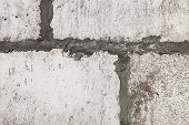 pic of mortar-joint  - Close up of the grey wall constructed of the concrete blocks - JPG