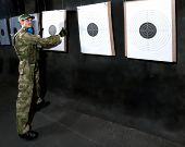 stock photo of shooting-range  - Man with target in shooting range in glases - JPG