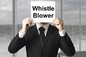 stock photo of blowers  - businessman in black suit hiding face behind sign whistle blower - JPG