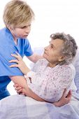 stock photo of crippled  - nurse helps the senior woman get up - JPG