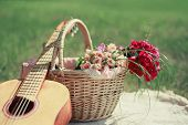 stock photo of gift basket  - Guitar basket and bouquet of flowers - JPG