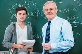 stock photo of motivation talk  - male student with a teacher in classroom - JPG