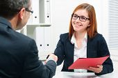 stock photo of recruiting  - Handshake to seal a deal after a job recruitment meeting - JPG
