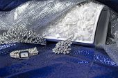 foto of clutch  - Set of female accessories of the clutch watches brooches and tiaras - JPG