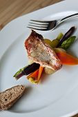 foto of mullet  - Fillet or red mullet and vegetables on a plate