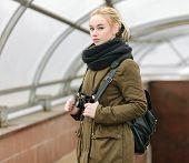 stock photo of dreadlocks  - Outdoors city portrait of young blonde hipster woman photographer with dreadlocks in scarf and military style olive parka - JPG