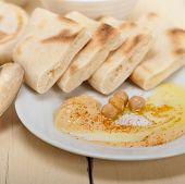 stock photo of chickpea  - traditional chickpeas Hummus with pita bread and paprika on top - JPG