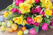 pic of easter flowers  - bunch of spring pink  tulips and yellow daffodil flowers with easter eggs - JPG