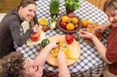stock photo of disability  - a group with a mentally disabled woman cooking together - JPG