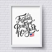stock photo of boutique  - Stylish Text for Fashion Boutique New York Concept with Small American Flag and a Hanger on a White Frame Hanging on a White Brick Wall - JPG
