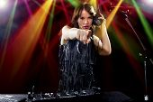 foto of emcee  - caucasian female dj using a mixer and computer to play mp3s - JPG