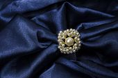 foto of brooch  - brooch for scarf with pearl on a blue background - JPG