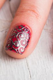 picture of nail paint  - . Beautiful female hands with nails painted nails. Art manicure. Art manicure. Creative manicure. Taking Close-up nails. Art nails. Nails art. Art manicured fingers. - JPG