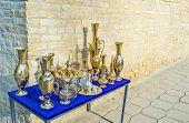 stock photo of stall  - The traditional uzbek dishware next to the stall at the Toqi Sarrafon market - JPG