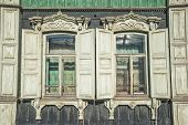 picture of siberia  - Detail of old wooden painted in green house in Tomsk Siberia Russia - JPG